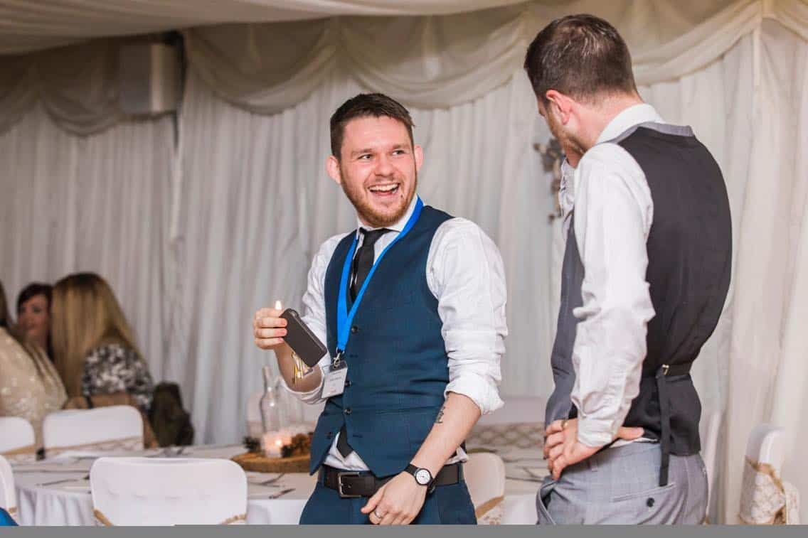 Professional magician Greg Holroyd performing pickpocket magic for wedding guests