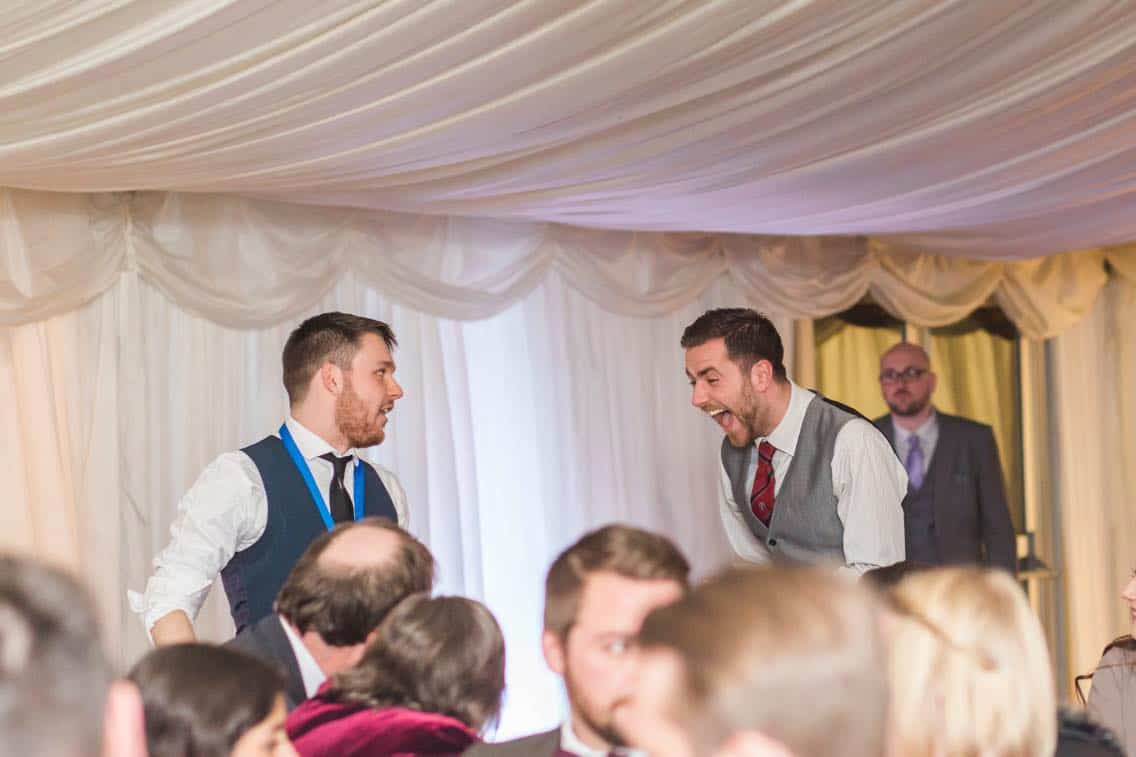 Professional magician Greg Holroyd performing close-up magic at a wedding breakfast
