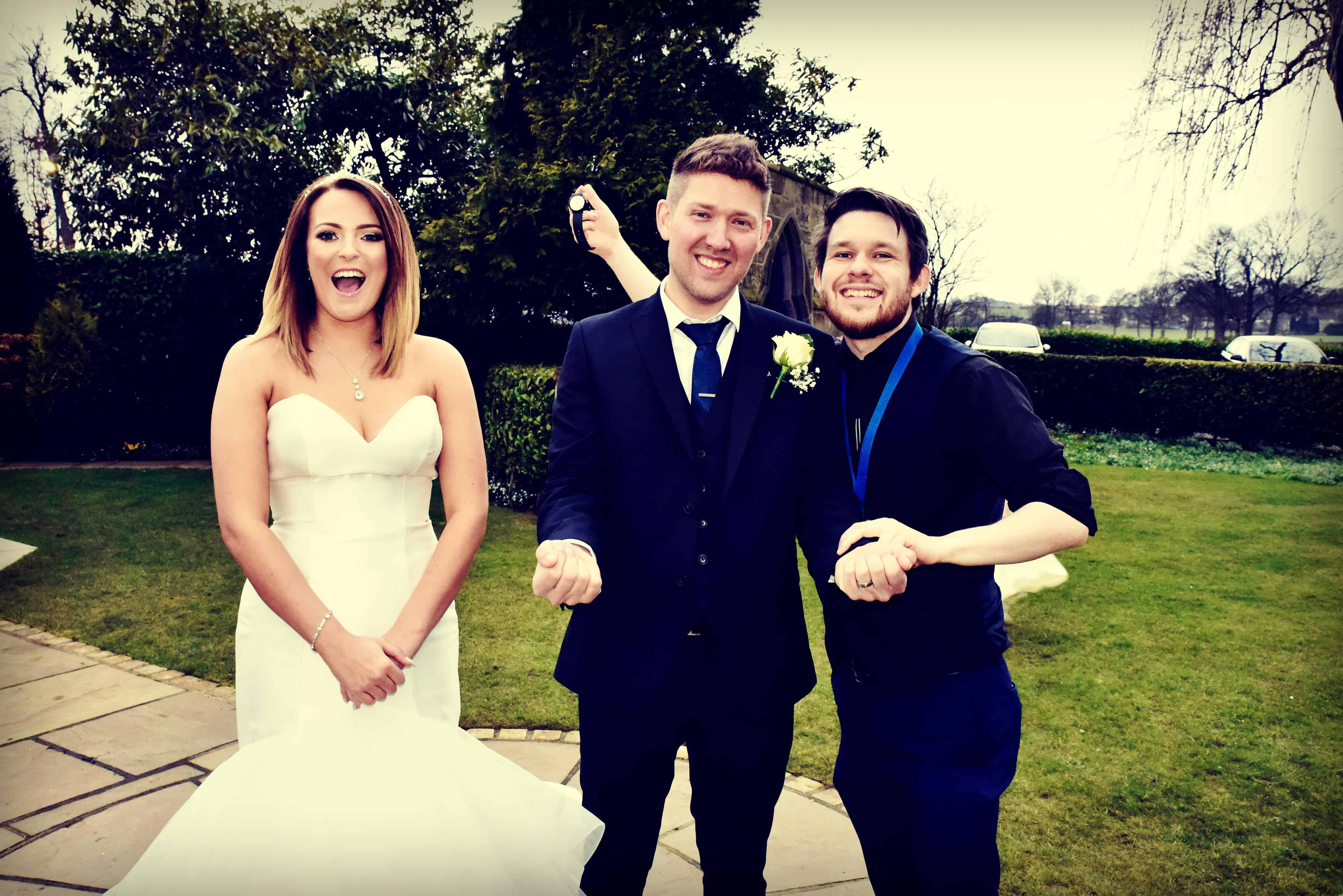 Professional Magician Greg Holroyd performing a small stand-up show for the Bride and Groom on their wedding day
